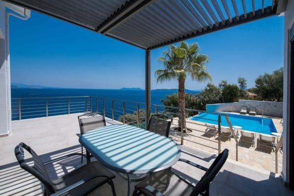 Outside balcony with view sea view and view on the swimming pool of luxury villa lefkas Greece. The balcony has electric lamelle sunroofs to create shadow